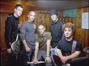 Robert Golden, left, Travis Montgomery, Kyle Kleeberger, Mark Montgomery, and Tim Strausbaugh were not allowed to perform as their Christian rock group, Pawn, at an anti-drug rally at Rossford High School. Supporters sued over the board's December, 2004 decision.