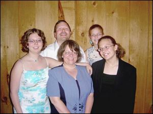Steven DalPra in a family photo, clockwise from his right, are daughters Rachele and Giovanna, wife Colleen, and daughter Elizabeth.
