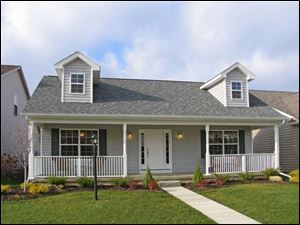 The home at 5637 Breezy Porch is offered at $183,500, including lot, and can be seen during regular office hours, Monday through Friday, from 9 a.m. to 4 p.m. For a private appointment, contact Mike Hojnacki at 419-467-3421.