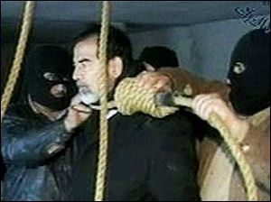 This video image released by Iraqi state television shows Saddam Hussein's guards wearing ski masks and placing a noose around the deposed leader's neck moments before his execution Saturday Dec. 30, 2006.