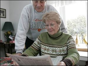 Thomas and Donna Hafner, looking over The Blade's stock listings in their Point Place home, said their contest picks are made up largely of stocks they have owned, including General Motors and Sun Microsystems.