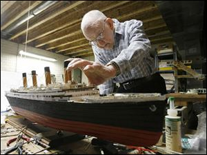 Jacques Rietzke, 82, a master model shipbuilder, works on his model of the Titanic. He says it is about 90 percent complete.