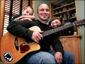 Tom Jackson with children Harry, 5, and Sophia, 7. Mr. Jackson plays 'alternakids' music for his family.