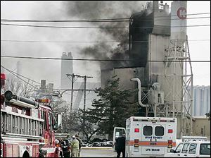 Firefighters work on the fire at the Kuhlman Corp. this afternoon.