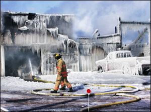 Perkins Township firefighters keep water going on a Hermes Dairy Farm structure.