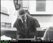 BANK-ROBBER-PULLS-GUN-ON-TELLER