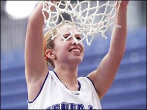 Anthony Wayne's Ashley Bromley takes her turn at cutting down the net after the Generals won their first girls basketball title.
