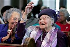 Woman-celebrates-turning-100-with-smiles-friends-and-family