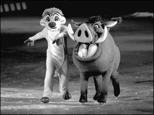 Timon the meerkat, left, and Pumbaa the warthog from The Lion King hit the ice.