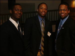 John Cole, left, Marcel Pringle, and Chris Mitchell were among the guests at the gathering for the new Toledo young professionals organization.