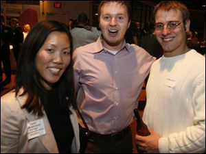 Tanya Pipatjarasgit, left, Kris Keating, and CJ Murawski at the EPIC Toledo reception.