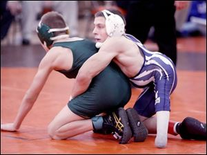 Napoleon's Brad Heinrichs competes against Clay's Josh Witt in the 103-pound division of the Southview Invitational, which Heinrichs won. Born with spina bifida, Heinrichs has had 23 major surgeries on his legs and back.