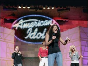 Contestants perform for judges at the Hollywood round of American Idol.