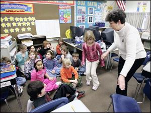 Bowling Green teacher Mary Ann Hoare ushers her third-grade students into the area of the classroom used for lockdowns.
