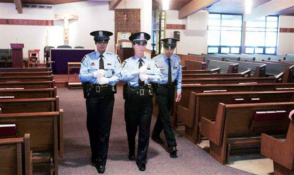 Tearful-honor-guard-prepares-for-officer-s-funeral