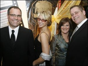 Steve and Michelle Atkinson, left, with Anne and Brian Schenk at Owens Community College for the Academy Awards party.