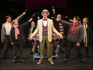 Candy Man  Steve Tipton in Willy Wonka is surrounded by,