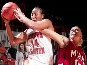 Carin Horne grabs a rebound against Miami.