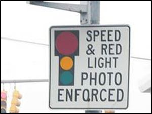 Automated cameras at select intersections across Toledo have generated $1.4 million for the city since 2001.