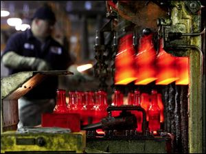 Red-hot beer bottles pour out of the Windsor, Colo., factory's forming machine at the rate of 600 a minute.
