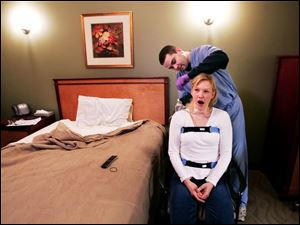 Electrodes are fitted to a patient at a sleep-study clinic operated by a St. Paul, Minn., hospital.