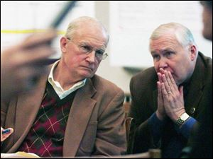 Mayor Carty Finkbeiner consults with his chief of staff, Robert