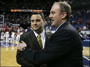 Xavier coach Sean Miller, left, greets Ohio State coach Thad