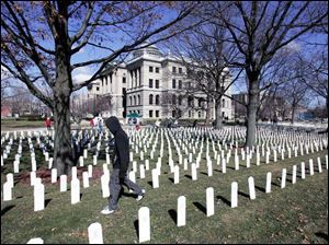 More than 3,000 grave markers planted in the Lucas County Courthouse lawn honor the war's fallen.