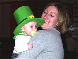 Megan Lokken holds her little leprechaun, her daughter Katie, at the Order of the Hibernian St. Patrick s Day Festival.