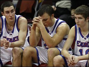 From left, Liberty-Benton s Nathan Hyde, Brandon Craft and Pat Wallace can t hide their disappointment in defeat.