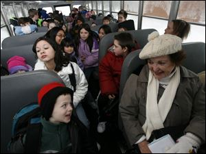 Blade columnist Mary Alice Powell chats as the bus heads for an Adrian school.