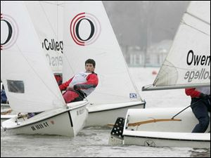 Three skippers from Owens Community College have their sailboats in tight quarters as they race against Michigan State.
