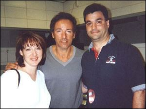 Karin and Jim Steel with Bruce Springsteen, center. Steel once was program director for WIOT-FM in Toledo.