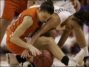 Bowling Green's Kate Achter battles for a loose ball with Arizona State's Reagan Pariseau. Achter was struggling all day. She had eight turnovers and was held scoreless.