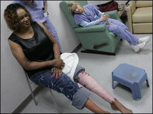 Maxine Richardson and nurses admire the effects of the makeup on the right leg that was airbrushed.