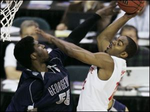 Ohio State's Ron Lewis goes to the basket against Georgetown's Roy Hibbert in last night's NCAA semifinal. Lewis had nine points for the Buckeyes (35-3), who will play for the national title tomorrow night. The only NCAA title in OSU history was in 1960.