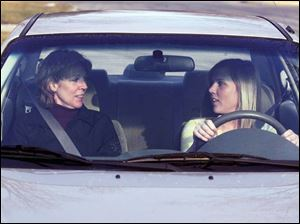 Haley Lancaster, 16, gets behind the wheel for some driving time with her mother, Sue Lancaster.