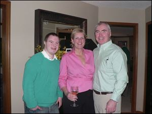 Mike Stanford, left, and his parents, Linda and Steve Stanford, gave their annual Margaritas and the Masters party at their home overlooking the Belmont Country Club golf course.