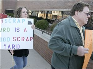 Sarah Nash, and other Monroe residents express their opposition to the scrap yard proposed for their city. Monroe council voted last week to rezone a site to accommodate such a facility.