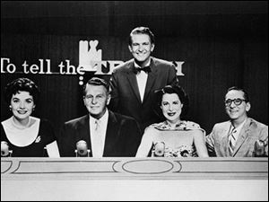 Kitty Carlisle Hart, second from right, is shown as a panelist on the television show 'To Tell The Truth,' for which she says she was best known. Master of ceremonies Bud Collyer, rear, poses with the panelists in 1957 who included Polly Bergen, left, Ralph Bellamy, Kitty Carlisle (as she was known professionally) and Hy Gardner.