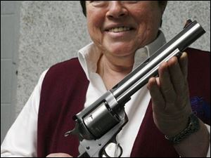 Theresa Cleland of Cleland's Outdoor World, with a .44 Magnum, has refused to sell to questionable customers.