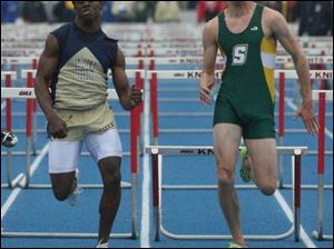 DaJon Booth of St. John s, left, and Paul Szeltner of Strongsville, push for the finish line in the 110-meter hurdles at the St. Francis Knight Relays. Booth took fi rst place.