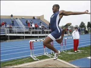 Kevin Koger of Whitmer long jumps 20 feet, 6 3/4 inches as he and teammate Jeremy Jones won the event at the Knight Relays.