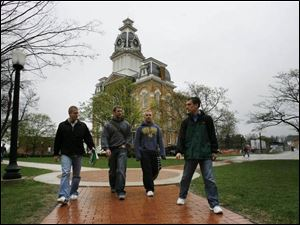 Heading to class at Hillsdale College are Jeff Brewer, Jeremiah Regan, Brandon Muri, and senior class President Hans Zeiger. Hillsdale is known as a conservative bastion.