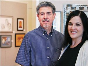 Robert Garcia, left, and Leslie Adams are the judges for the Art-A-Fair exhibit at the Main Library.