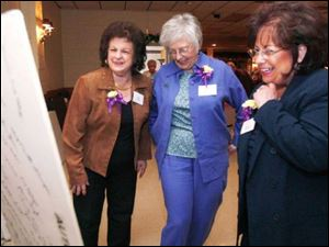 Rose Dinardo Giese, left, who graduated in 1945, Janet Mills, center, whose husband attended Waite, and Shirley Norton, Ms. Giese s daughter, share a laugh while looking at a white-board display adorned with alumni signatures on its back.
