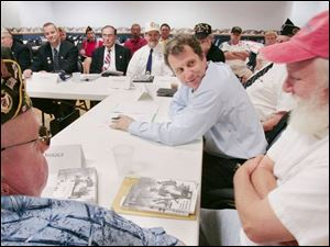 Sen. Sherrod Brown, center, holds roundtable talks with veterans at American Legion Post 587 on West Alexis Road.