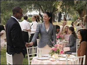 Sterling K. Brown, Kim Delaney, center, and Catherine Bell are three of the principal actors in Army Wives.