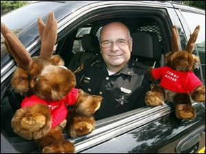 Tommy Moose may only be a stuffed toy, but he's important enough to ride in the front seat of the cruiser with Ottawa County Sheriff's Deputy Jeff Hickman on his patrols.