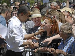 Democratic presidential hopeful Sen. Barak Obama draws a smiling crowd during a recent campaign stop in Reno, Nev.